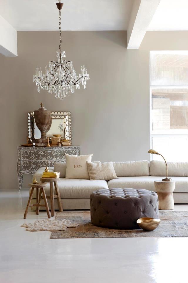 Eclectic look living room  Eclectic look living room Eclectic living room beige crystal chandelier darker pouf