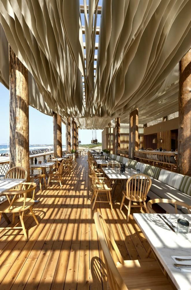 Outdoor Restaurant Styles and Ideas  Outdoor Restaurant Styles and Ideas Barbouni Greece Outdoor restaurant ideas beach view wood and white vith layered curtains