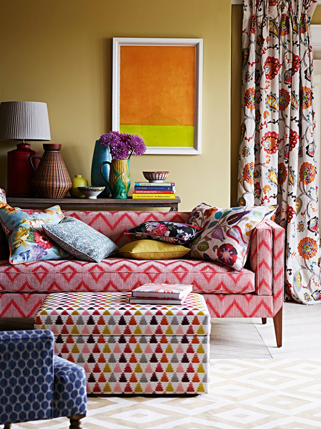 colours and patterns Mix Your Fabrics, Colours and Patterns with No Fear Mixed Fabrics flower pillows gemoetris red sofa orange yellow painting