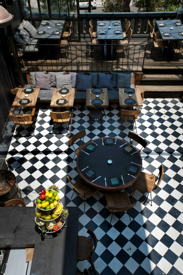 Outdoor Restaurant Styles and Ideas  Outdoor Restaurant Styles and Ideas RomitaComedor Mexico Outdoor Restauarnt Ideas Black White Tiles Round Table Dark Fabric