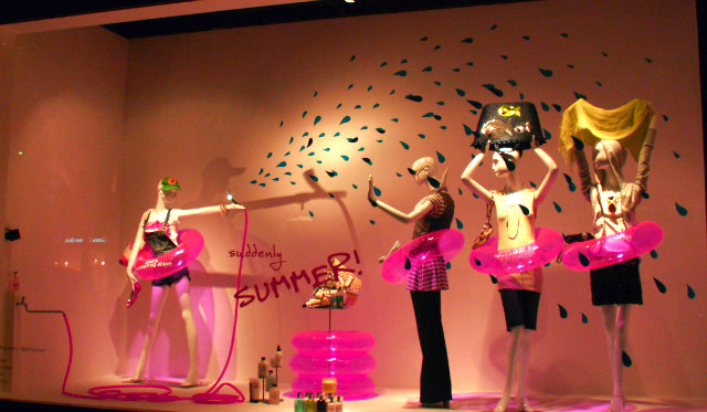 hot pink life ring window display  Summer WINDOW shopping? yes please Summer Window safety doughnuts hotpink