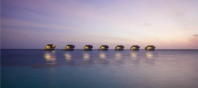 10 Stunning Design Hotels in Asia  10 Stunning Design Hotels in Asia jumeirah vittaveli ocean suites dusk hero
