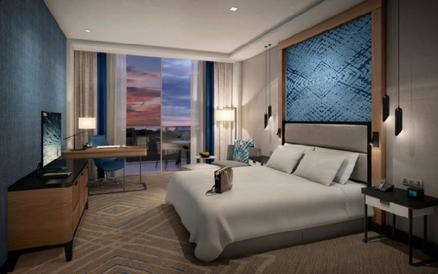7 Striking Decor Ideas To Steal From Areen Design  7 Striking Decor Ideas To Steal From Areen Design Hospitality Cape Sierra Hilton Guest Bedroom Night View 1 670x419 1