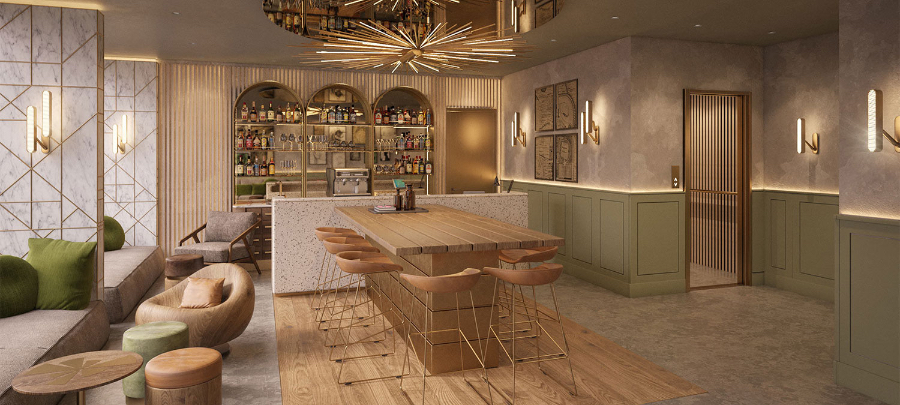 The bar of a Hilton Hotel, with a big gold chandelier, an isle with salmon colored chairs surrounding it and some small round tables with sofas surrounding.  kitzig design studios Kitzig Design Studios- From Germany to the World Interior Motto Hilton Hotel 01 1800x810 1 1