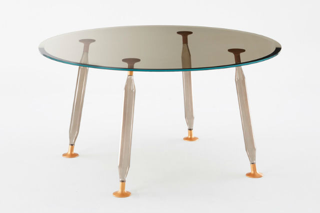 Philippe starck launches lady hio colored dining tables for Philippe starck glass table