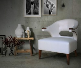 A fierce white synthetic leather accent chair ideal for a modern home décor.