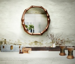 A large round mirror as the center piece in a Japanese villa décor with matching wood and brass stools.