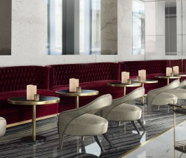 Many agree that you can never go wrong with neutrals. Pair them with an accent colour and you will get a fantastic combination. In this bar design, BOURBON Sofa, fully upholstered in velvet, stands ou
