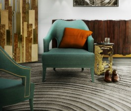 A midcentury living room with warm colors, perfect for an autumn and winter décor. Brass, wood, twill and hand-tufted tencel work very well together. The blue twill accent chair with the small gold si