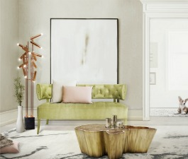 A classic living room décor with nature color tones where a mid century modern 2 seat sofa, a copper floor lamp, a brass and wood root coffee table and a hand tufted rug are blended harmoniously.