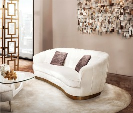 Upholstered with white glossy velvet, PEARL contemporary sofa offers a delicate and surprising touch. This art deco inspired sofa brings a warm and cosy feeling to your living room set.